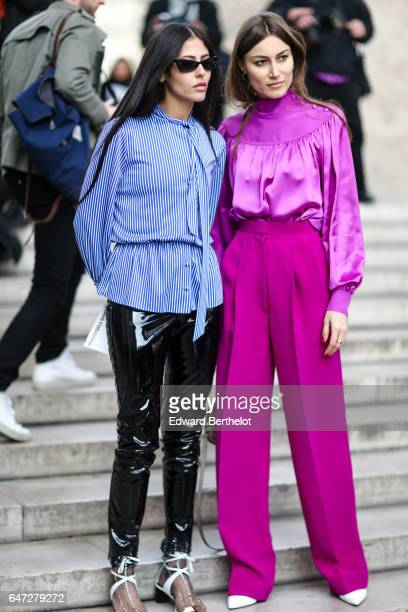 Gilda Ambrosio wears a blue striped shirt and black vinyl pants outside the Paco Rabanne show during Paris Fashion Week Womenswear Fall/Winter...