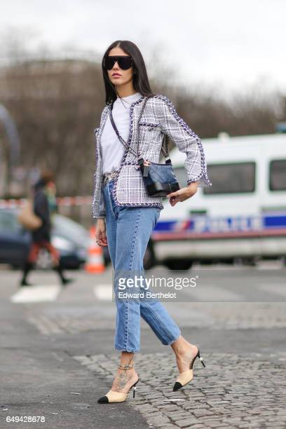 Gilda Ambrosio wears a Chanel tweed jacket a Chanel bag blue jeans and Chanel shoes outside the Chanel show during Paris Fashion Week Womenswear...
