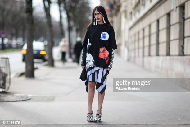 Gilda Ambrosio wears a Miu Miu dress outside the Miu Miu show during Paris Fashion Week Womenswear Fall/Winter 2017/2018 on March 7 2017 in Paris...