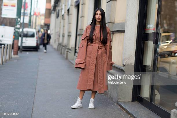 Gilda Ambrosio wears a peach robestyle dress with oversized sleeves after the Marni show during Milan Men's Fashion Week Fall/Winter 2017/18 on...