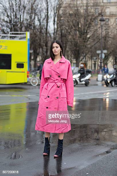 Gilda Ambrosio wears a pink Alessandra Rich trench at the Margiela Couture show at Htel des Invalides on January 27 2016 in Paris France