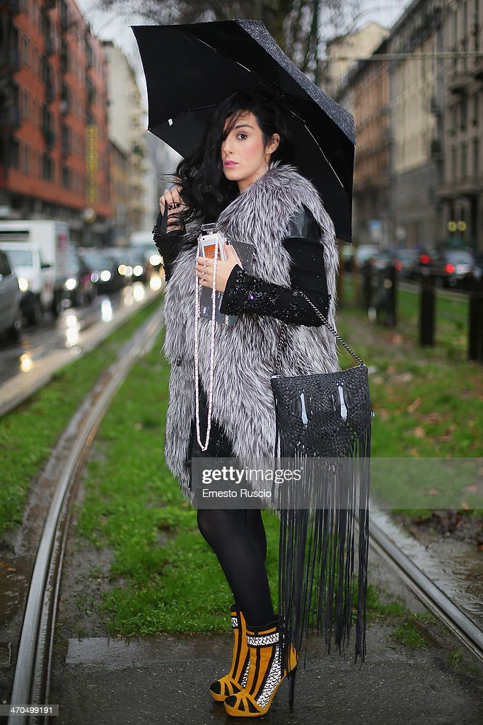 Gilda Koral Flora wears Yves Salomon fur, Barbara Bonner bag on day 1 of Milan Fashion Week Womenswear Autumn/Winter 2014 on February 19, 2014 in Milan, Italy.