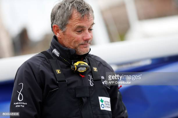 Gildas Mahe French skipper of 'Action contre la faim' looks on after finishing 5th of the 48th Solitaire du FigaroUrgo solo sailing race on June 23...