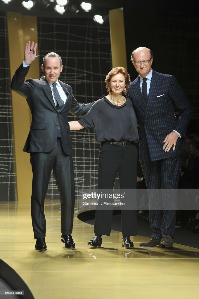 Gildo Zegna, <a gi-track='captionPersonalityLinkClicked' href=/galleries/search?phrase=Anna+Zegna&family=editorial&specificpeople=3053409 ng-click='$event.stopPropagation()'>Anna Zegna</a> and Paolo Zegna acknowledge the applause of the audience after the the Ermenegildo Zegna show as part of Milan Fashion Week Menswear Autumn/Winter 2013 on January 12, 2013 in Milan, Italy.