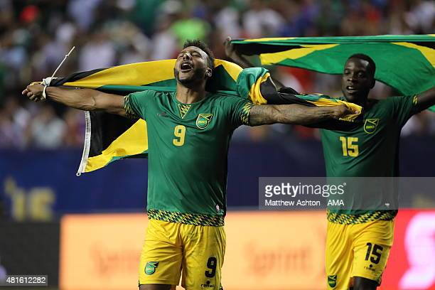 Giles Barnes and JeVaughn Watson of Jamaica celebrate the 12 victory with their national flags after the 2015 CONCACAF Gold Cup Semifinal between USA...