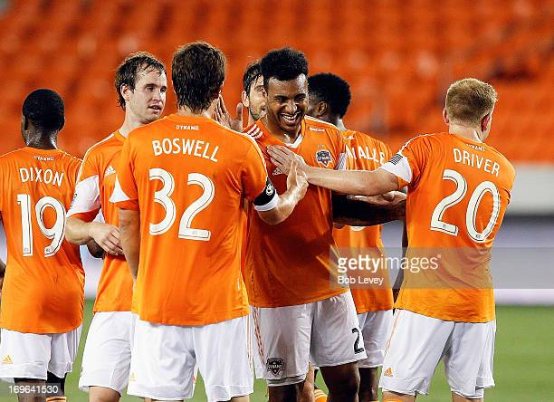 Giles Barnes is congratulated by Bobby Boswell Andrew Driver and Brian Ownby of Houston Dynamo after scoring on a direct kick in the second half...