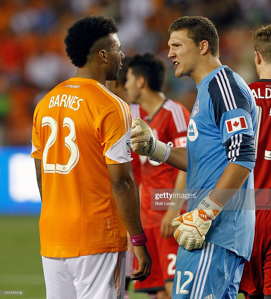 Giles Barnes #23 of Houston Dynamo and Joe Bendik #12 of Toronto FC have words during the second half at BBVA Compass Stadium on June 22, 2013 in Houston, Texas.