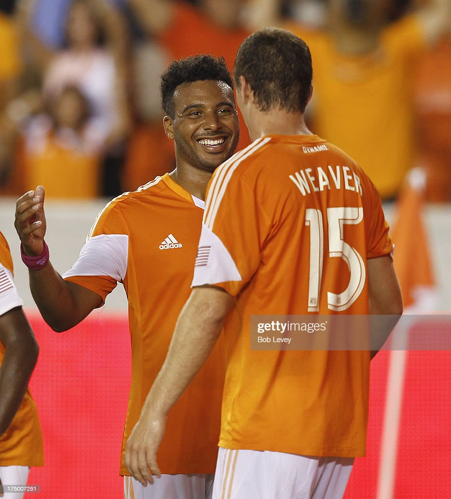 Giles Barnes #23 of Houston Dynamo congratulates Cam Weaver #15 of Houston Dynamo after scoring against the Chicago Fire in the second half at BBVA Compass Stadium on July 27, 2013 in Houston, Texas.