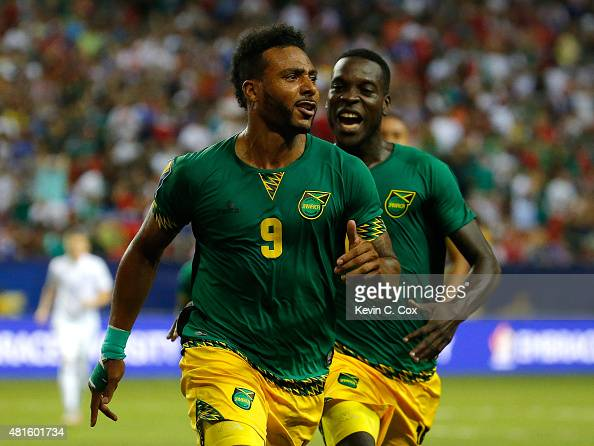 Giles Barnes of Jamaica celebrates scoring the second goal against the United States of America with JeVaughn Watson during the 2015 CONCACAF Golf...