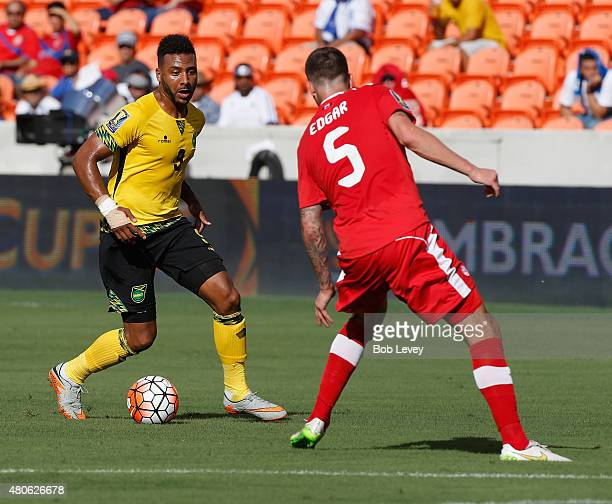 Giles Barnes of Jamaica looks to move around David Edgar of Canada at BBVA Compass Stadium on July 11 2015 in Houston Texas