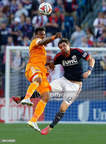 Giles Barnes of the Houston Dynamo battles Andy Dorman of the New England Revolution in the 1st half at Gillette Stadium on April 12 2014 in Foxboro...