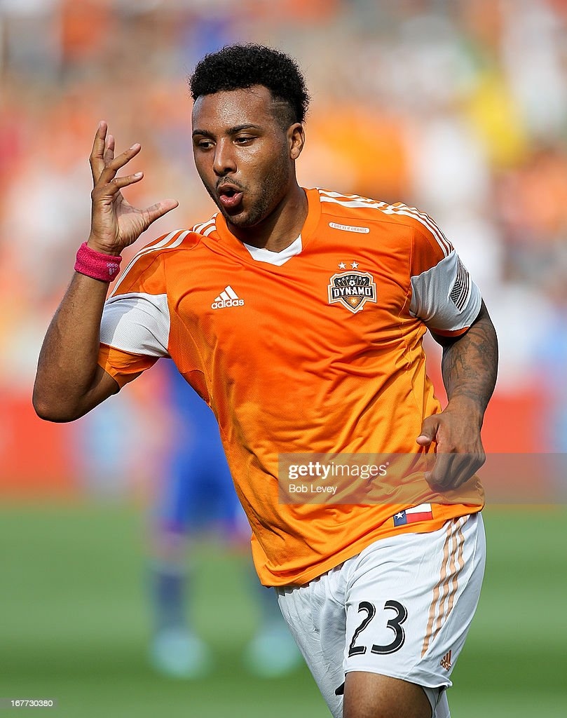 Giles Barnes #23 of the Houston Dynamo celebrates after scoring in the second half against the Colorado Rapids at BBVA Compass Stadium on April 28, 2013 in Houston, Texas. Houston Dynamo and Colorado Rapids tied 1-1.