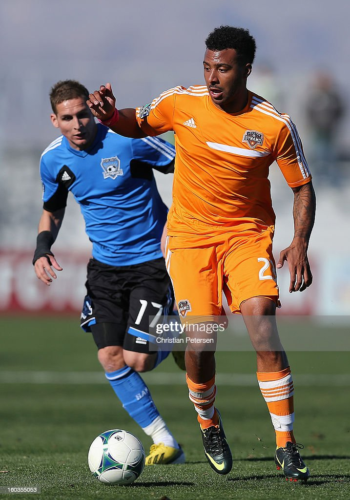 Giles Barnes #23 of the Houston Dynamo controls the ball past Sam Garza #17 of the San Jose Earthquakes during The Desert Friendlies Presented By FC Tucson at Kino Sports Complex on January 29, 2013 in Tucson, Arizona. The Earthquakes defeated the Dynamo 2-0.