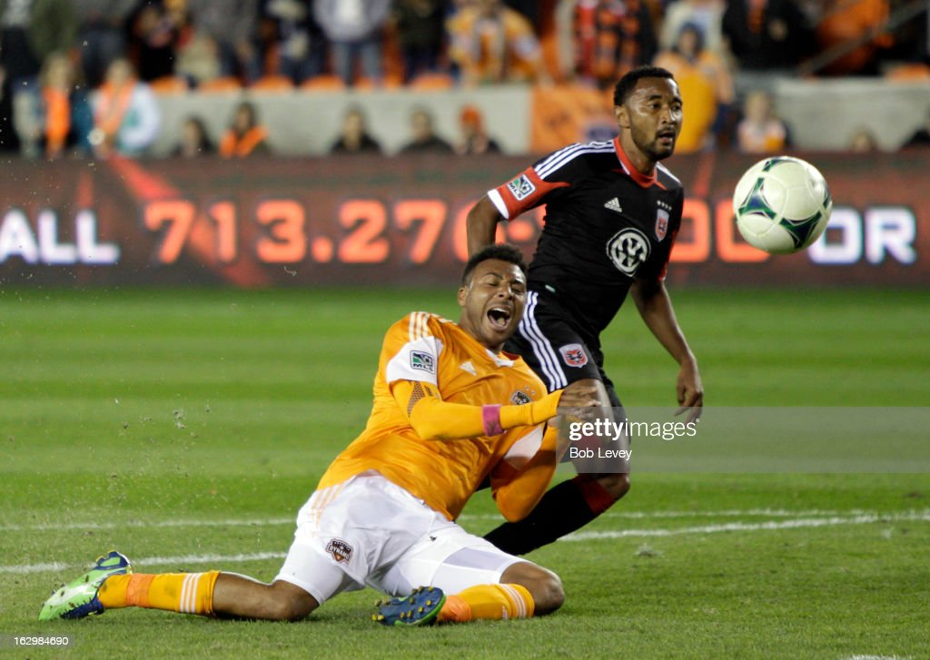 Giles Barnes #23 of the Houston Dynamo is tackled from behind by James Riley #2 of the D.C. United during second half action at BBVA Compass Stadium on March 2, 2013 in Houston, Texas. Houston won 2-0.