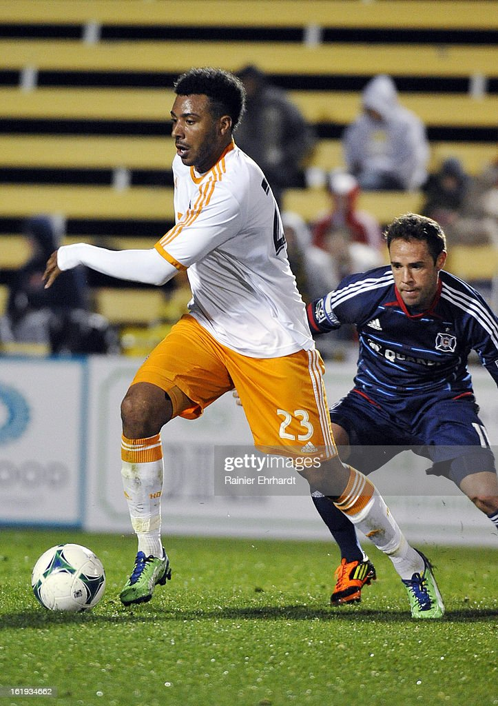 Giles Barnes #23 of the Houston Dynamo looks to pass against the Chicago Fire during the second half of their game at Blackbaud Stadium on February 16, 2013 in Charleston, South Carolina.