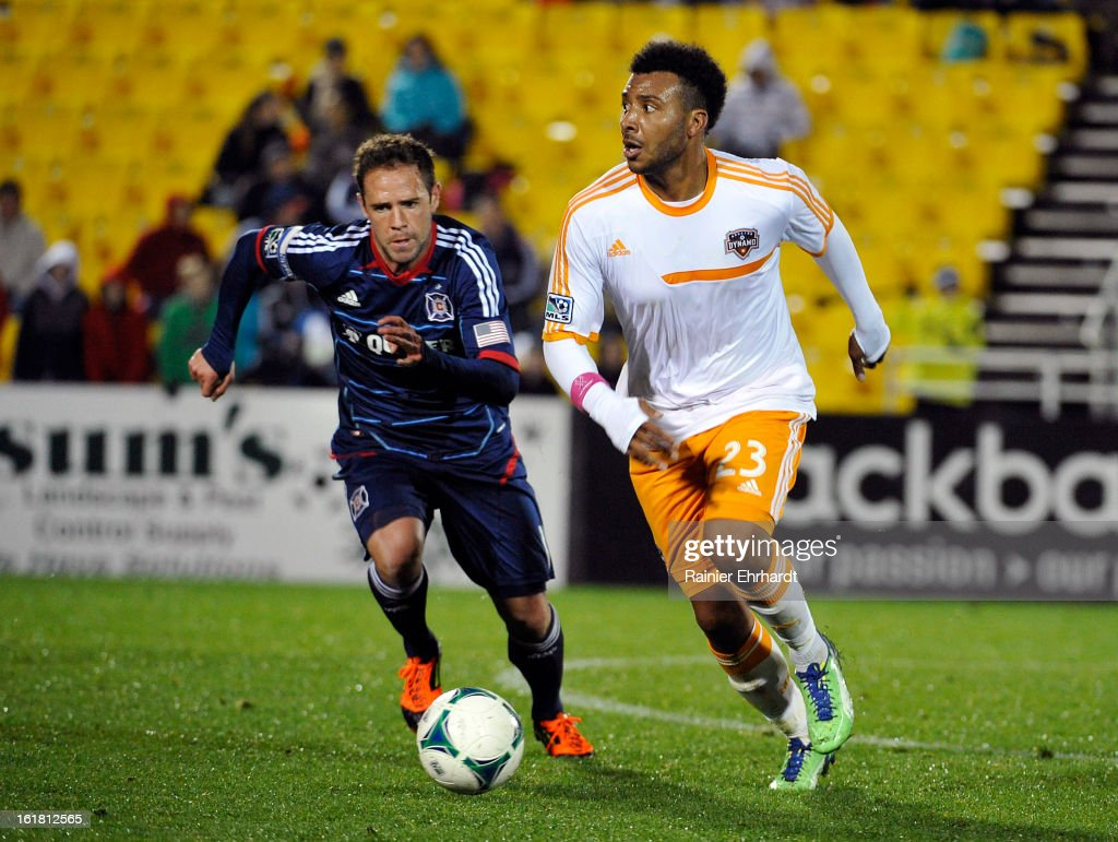 Giles Barnes #23 of the Houston Dynamo runs with the ball as <a gi-track='captionPersonalityLinkClicked' href=/galleries/search?phrase=Daniel+Paladini&family=editorial&specificpeople=5339683 ng-click='$event.stopPropagation()'>Daniel Paladini</a> #11 of the Chicago Fire defends during the second half of their game in the Carolina Challenge Cup at Blackbaud Stadium on February 16, 2013 in Charleston, South Carolina.