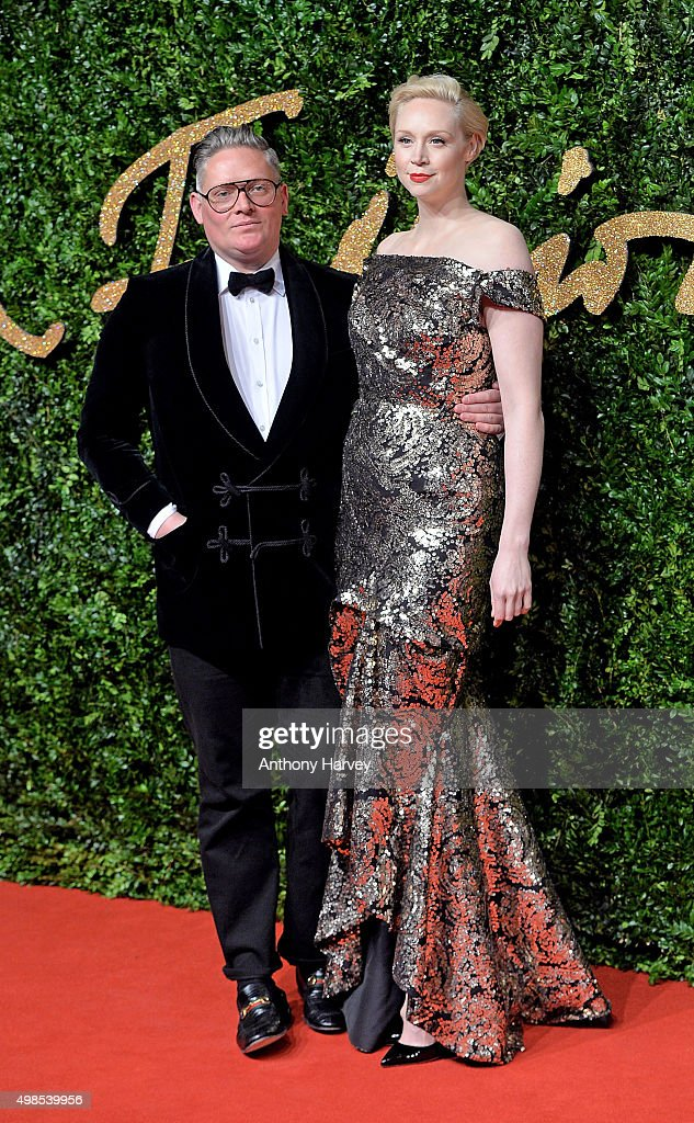 Giles Deacon and Gwendoline Christie attend the British Fashion Awards 2015 at London Coliseum on November 23, 2015 in London, England.