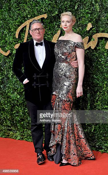 Giles Deacon and Gwendoline Christie attend the British Fashion Awards 2015 at London Coliseum on November 23 2015 in London England