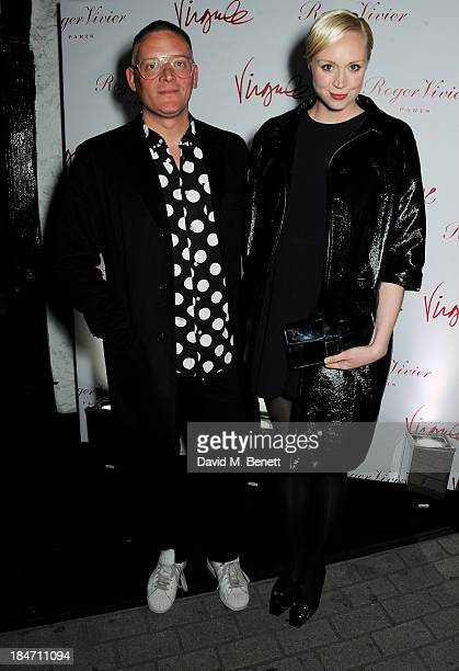 Giles Deacon and Gwendoline Christie attend the Roger Vivier Virgule London launch party hosted by Atlanta de Cadenet Ines de la Fressange and Bruno...