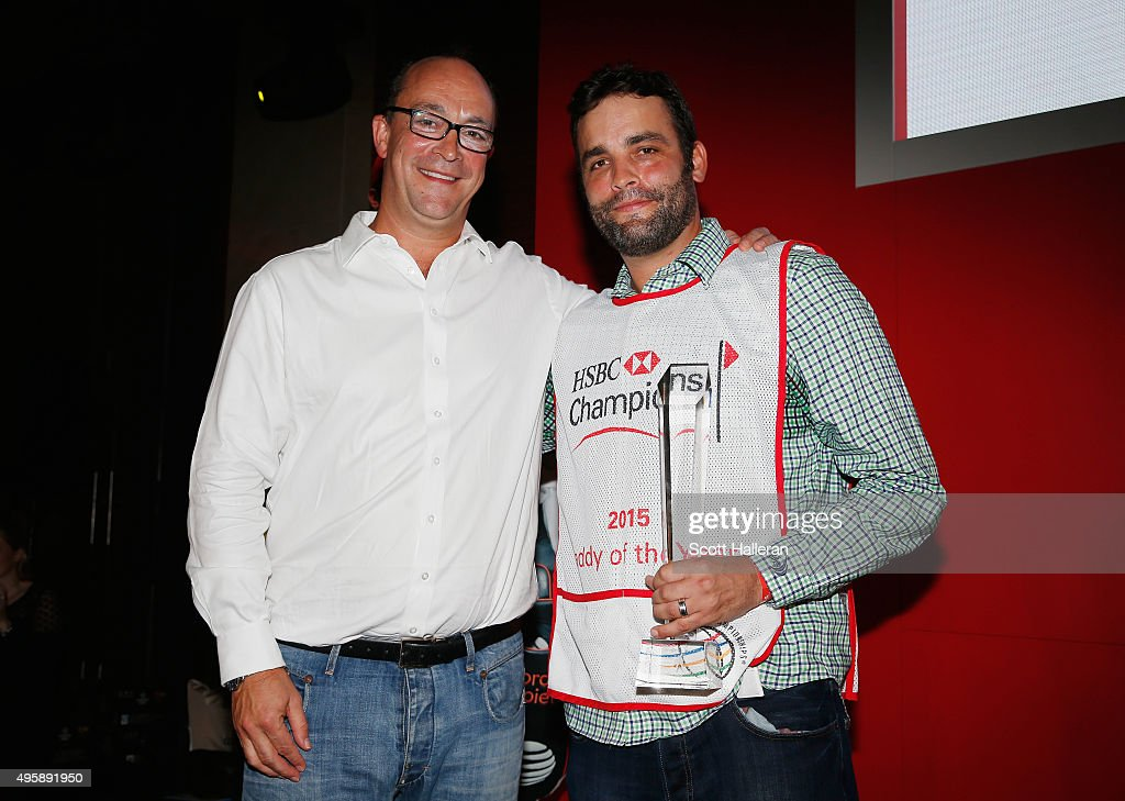 Giles Morgan, Global Head of Sponsorship and Events for HSBC, poses with Michael Greller on stage after Greller was named 2015 Caddy of the Year at the WGC - HSBC Champions on November 5, 2015 in Shanghai, China.