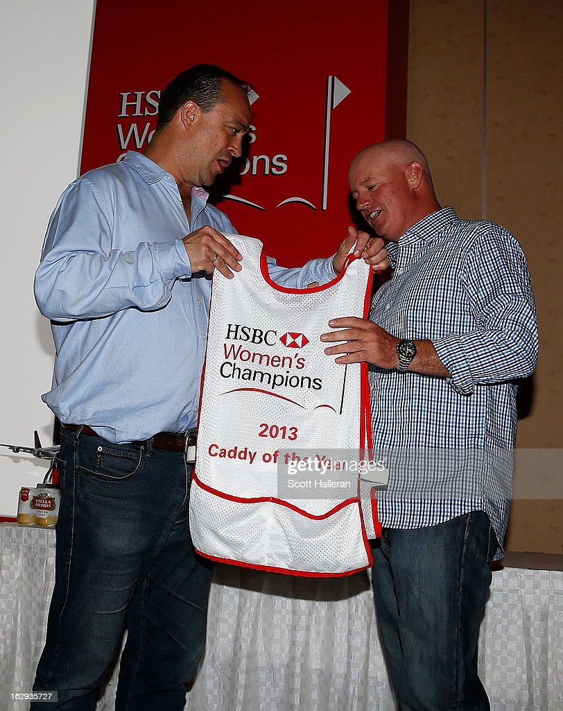Giles Morgan (L) Global Head of Sponsorship + Events, HSBC presents a bib to 2013 Caddy of the Year <a gi-track='captionPersonalityLinkClicked' href=/galleries/search?phrase=Travis+Wilson+-+Golf+Caddy&family=editorial&specificpeople=15147345 ng-click='$event.stopPropagation()'>Travis Wilson</a> at Marina Sands after the second round of the HSBC Women's Champions on March 1, 2013 in Singapore, Singapore.