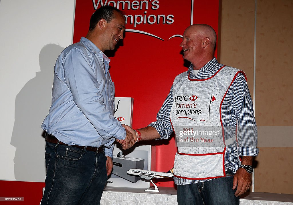 Giles Morgan (L) Global Head of Sponsorship + Events, HSBC presents a bib to 2013 Caddy of the Year <a gi-track='captionPersonalityLinkClicked' href=/galleries/search?phrase=Travis+Wilson+-+Caddie&family=editorial&specificpeople=15147345 ng-click='$event.stopPropagation()'>Travis Wilson</a> at Marina Sands after the second round of the HSBC Women's Champions on March 1, 2013 in Singapore, Singapore.