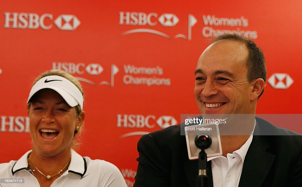 Giles Morgan, Global Head of Sponsorship + Events, HSBC (R) speaks with the media as Suzann Pettersen of Norway looks on prior to the start of the HSBC Women's Champions at the Sentosa Golf Club on February 26, 2013 in Singapore, Singapore.