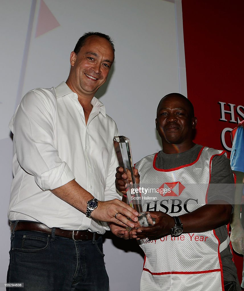 Giles Morgan (L) Group Head of Sponsorship HSBC Holdings poses with Zack Rasego at the Caddy of the Year awards at the WGC HSBC Champions at the Mission Hills Resort on November 2, 2012 in Shenzhen, China.