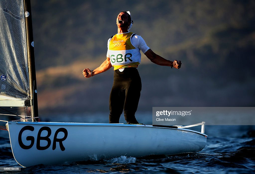 Giles Scott of Great Britain reacts after sealing the gold medal in the Finn class ra on Day 9 of the Rio 2016 Olympic Games at the Marina da Gloria on August 14, 2016 in Rio de Janeiro, Brazil.
