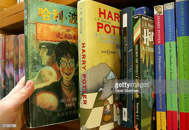 Gili BarHillel shows her collection of Harry Potter book translations in her office June 23 2003 in Tel Aviv BarHillel has translated all four of the...
