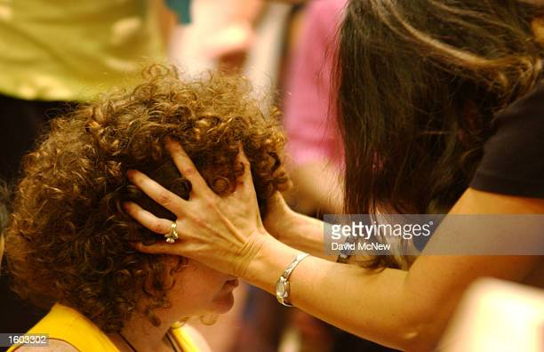 Gilia Chazan receives a healing treatment from Carol Francis during Fancis'' workshop on shamanism at the International Hypnosis Federation''s Mind...