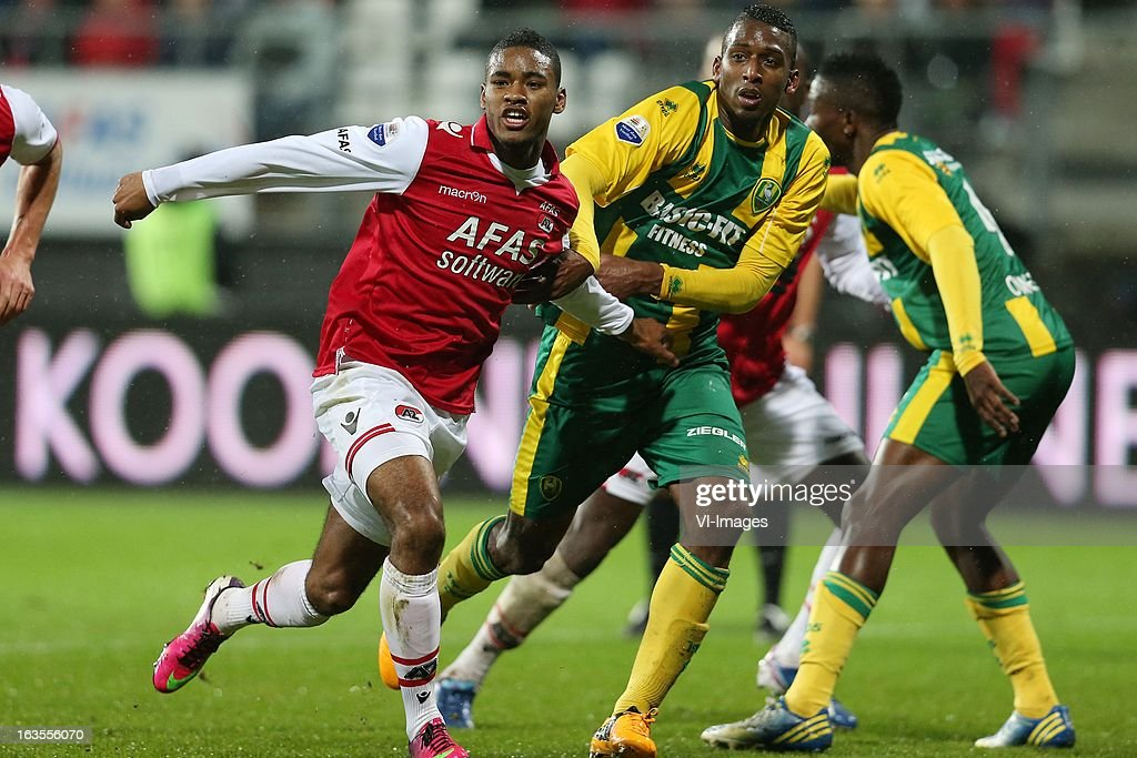 Giliano Wijnaldum of AZ ,Dion Malone of ADO Den Haag during the Dutch Eredivisie match between AZ Alkmaar and ADO Den Haag at the AFAS Stadium on march 09, 2013 in Alkmaar, The Netherlands