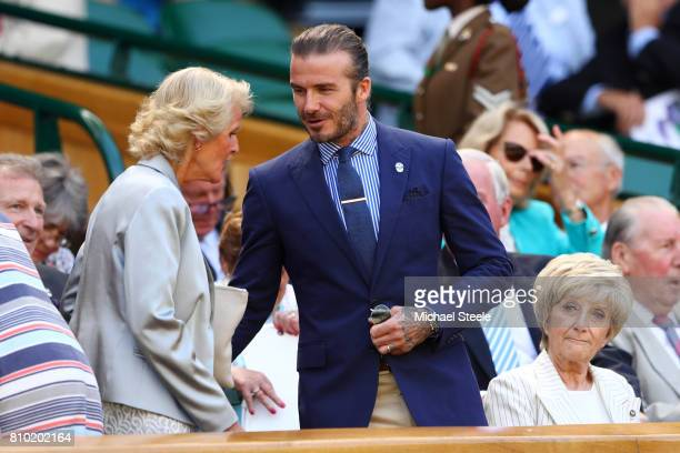 Gill Brook greets David Beckham in the centre court royal box on day five of the Wimbledon Lawn Tennis Championships at the All England Lawn Tennis...