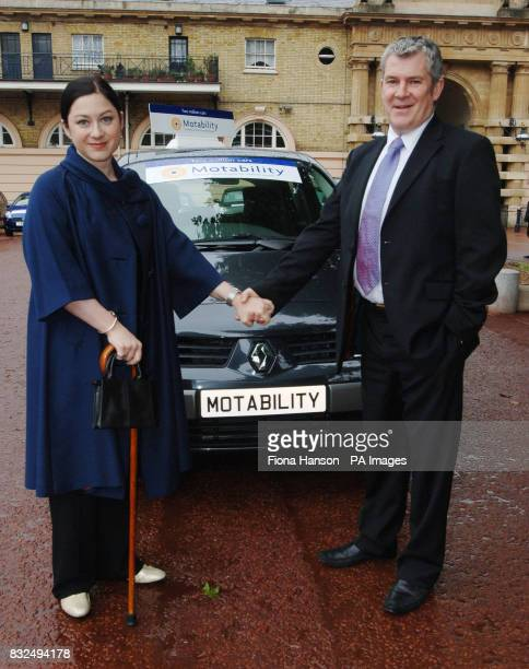 Gill Hicks who lost both legs in the London bombings with husband Joe Kerr in front of an especially adapted Renault Scenic the keys of which were...