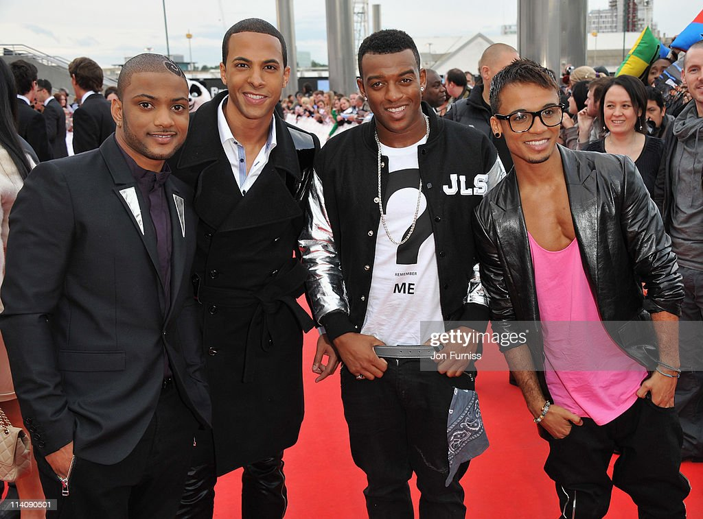 JB Gill, <a gi-track='captionPersonalityLinkClicked' href=/galleries/search?phrase=Marvin+Humes&family=editorial&specificpeople=2887070 ng-click='$event.stopPropagation()'>Marvin Humes</a>, <a gi-track='captionPersonalityLinkClicked' href=/galleries/search?phrase=Oritse+Williams&family=editorial&specificpeople=5739700 ng-click='$event.stopPropagation()'>Oritse Williams</a> and <a gi-track='captionPersonalityLinkClicked' href=/galleries/search?phrase=Aston+Merrygold&family=editorial&specificpeople=5739699 ng-click='$event.stopPropagation()'>Aston Merrygold</a> of JLS arrive for the L'Oreal National Movie Awards 2011 at Wembley Arena on May 11, 2011 in London, England.