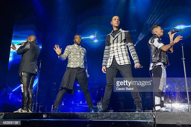 Gill Ortise Wiliams Marvin Humes and Aston Merrygold of JLS performs on stage at Nottingham Capital FM Arena on December 4 2013 in Nottingham United...
