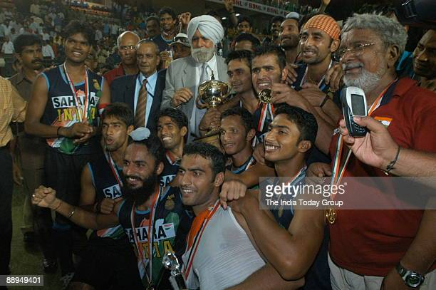Gill President of the Indian Hockey Federation and former DGP Punjab along with Indian Hockey players pose with their trophy and medals as they...