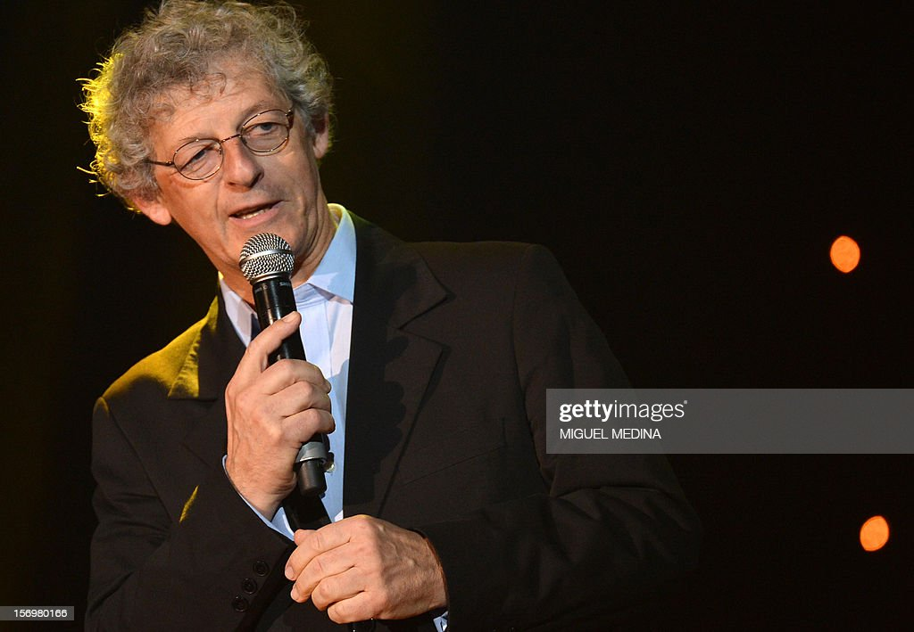 Gilles Amado speaks on stage after being awarded with the Grand Prix of audiovisual's authors during the SACEM (Societe des auteurs, compositeurs et editeurs de musique) Grand Prix awards ceremony on November 26, 2012 at the Casino de Paris. Every year the SACEM Grand Prix awards identify favourites among creators from the music, entertainment and audiovisual worlds and the media. AFP PHOTO MIGUEL MEDINA