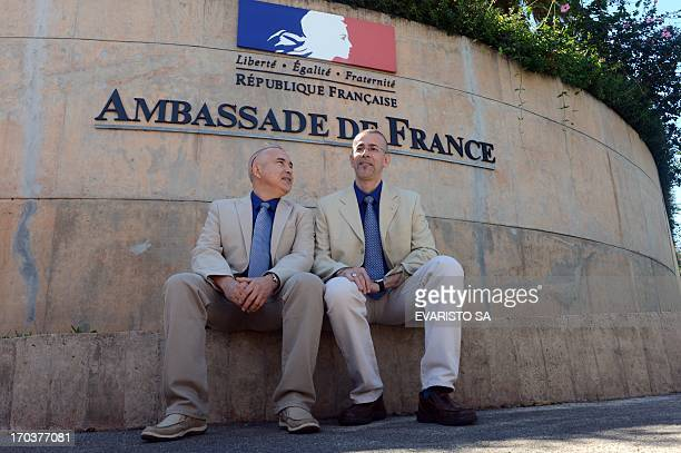 Gilles Barral 51 and Didier Ounnas pose at the entrance of the French Embassy in Brasilia on June 12 2013 This is the first gay marriage of two...