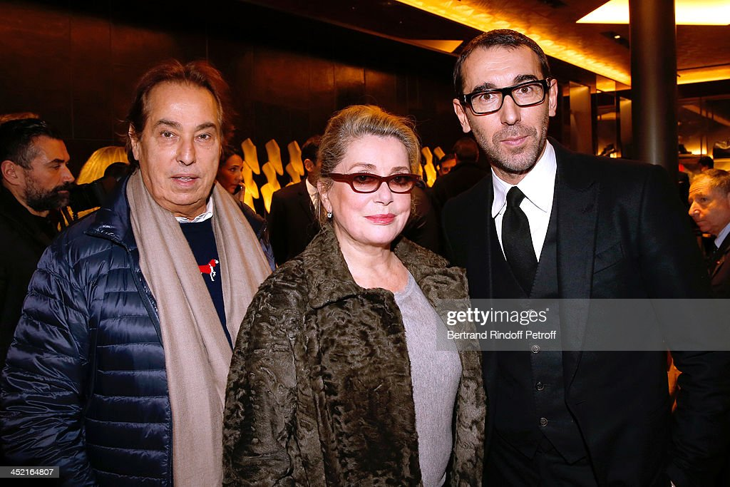 Gilles Dufour, actress <a gi-track='captionPersonalityLinkClicked' href=/galleries/search?phrase=Catherine+Deneuve&family=editorial&specificpeople=123833 ng-click='$event.stopPropagation()'>Catherine Deneuve</a> and Fashion designer of Berluti, Alessandro Sartori attend Berluti Flagship Store Opening on November 26, 2013 in Paris, France.