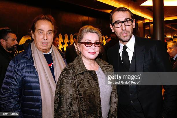 Gilles Dufour actress Catherine Deneuve and Fashion designer of Berluti Alessandro Sartori attend Berluti Flagship Store Opening on November 26 2013...