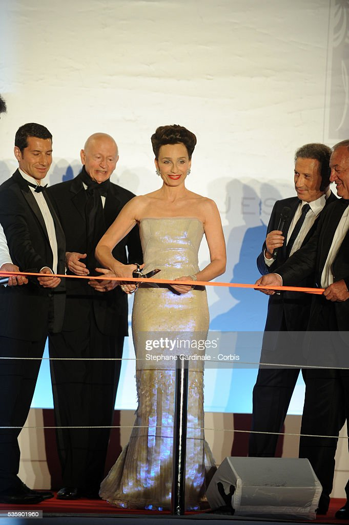 Gilles Jacob, Kristin Scott Thomas, Michel Drucker and Michel Brochant at the Opening Dinner during the 63rd Cannes International Film Festival.