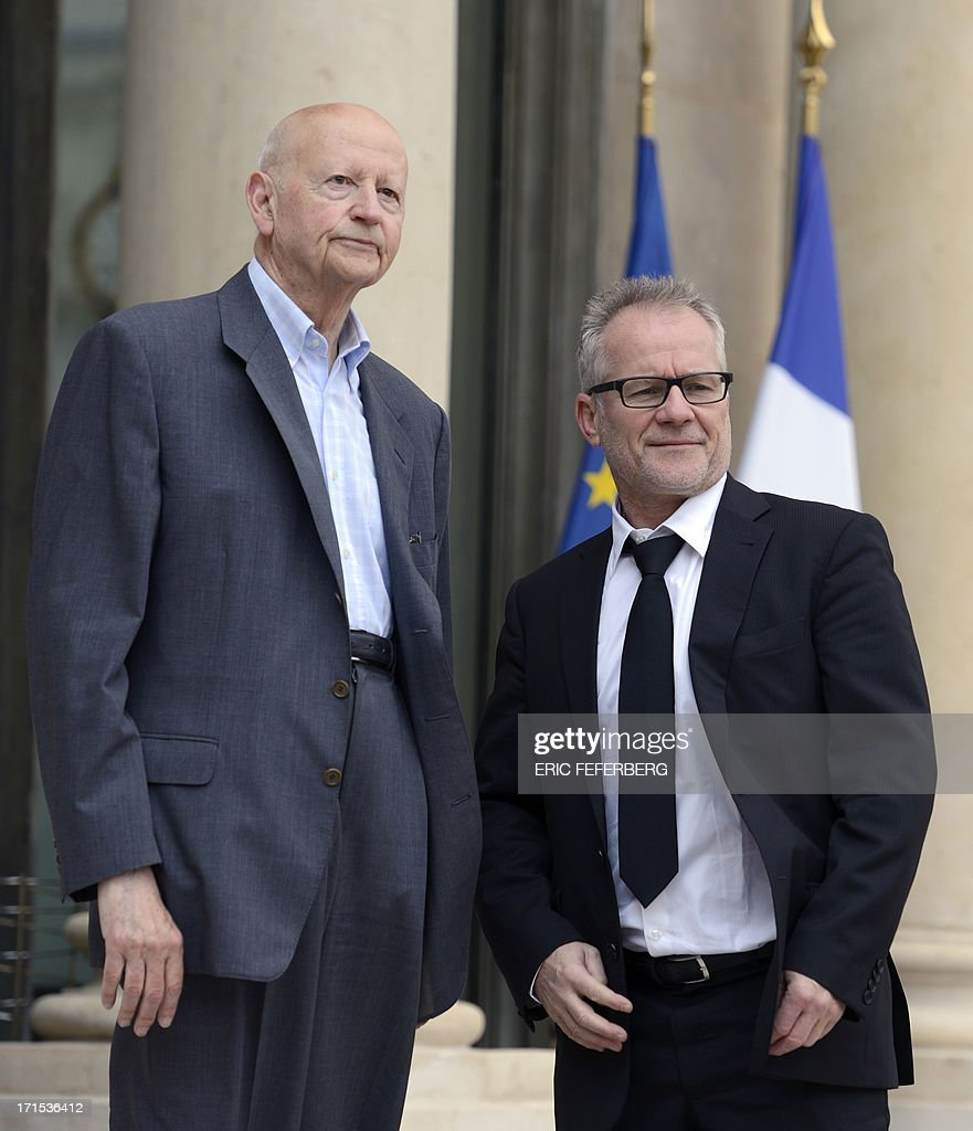 Gilles Jacob, President of the Cannes Film Festival (L) and the general delegate of the festival Thierry Fremaux arrive on June 26, 2013 at the Elysee palace in Paris for a lunch with the French President and the winners of the 2013 Palme d'Or.