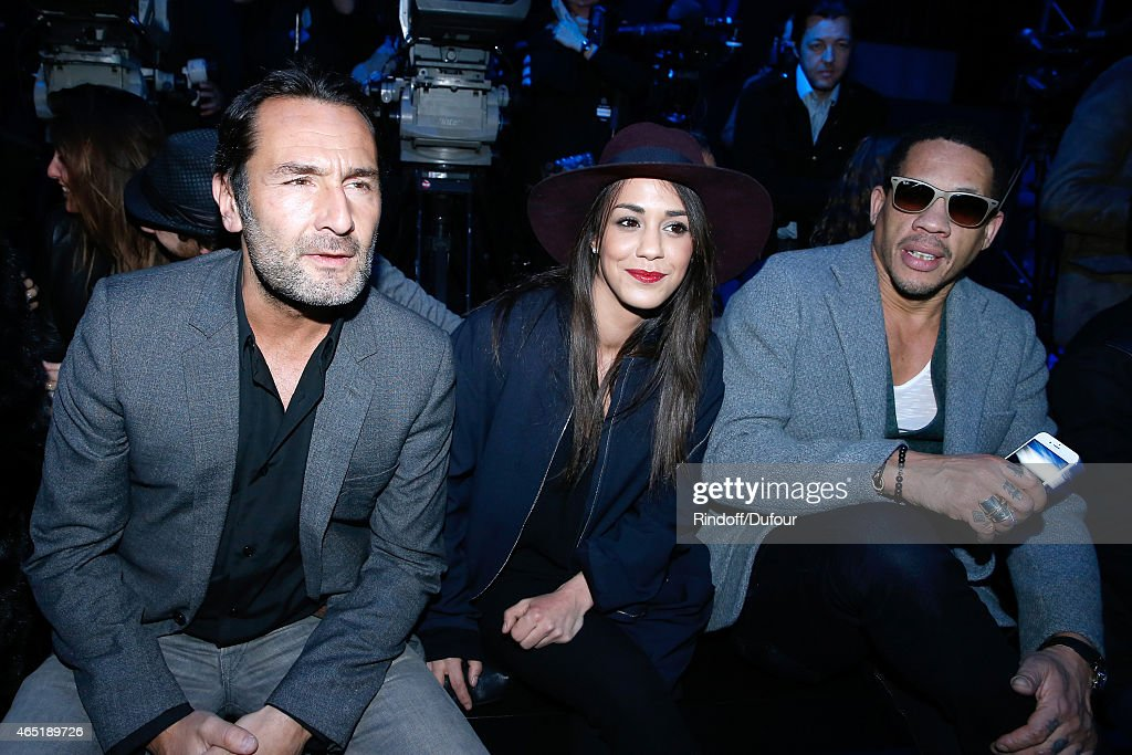 <a gi-track='captionPersonalityLinkClicked' href=/galleries/search?phrase=Gilles+Lellouche&family=editorial&specificpeople=626596 ng-click='$event.stopPropagation()'>Gilles Lellouche</a>, Alice Belaidi and JoeyStarr attend the ETAM show as part of the Paris Fashion Week Womenswear Fall/Winter 2015/2016. Held at Piscine Molitor on March 3, 2015 in Paris, France.
