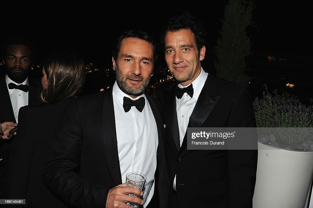 <a gi-track='captionPersonalityLinkClicked' href=/galleries/search?phrase=Gilles+Lellouche&family=editorial&specificpeople=626596 ng-click='$event.stopPropagation()'>Gilles Lellouche</a> and <a gi-track='captionPersonalityLinkClicked' href=/galleries/search?phrase=Clive+Owen&family=editorial&specificpeople=201515 ng-click='$event.stopPropagation()'>Clive Owen</a> attend the 'Blood Ties' cocktail and party hosted by Dior at Club by Albane in Bulgari Rooftop on May 20, 2013 in Cannes, France.
