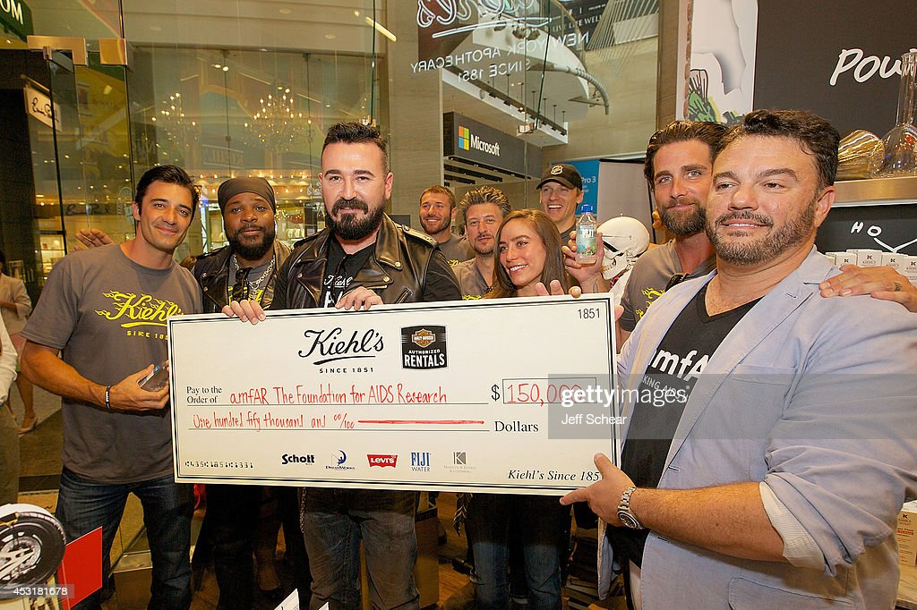 Gilles Marini, Malcolm-Jamal Warner, Chris Salgardo, Ben Cohen, Conrad Leach, Melissa Sears, Teddy Sears, Grant Reynolds, and Kevin Robert Frost attend Kiehl's LifeRide For amfAR Co-hosted By FIJI Water at Kiehl's Chicago Stores on August 4, 2014 in Chicago, Illinois.