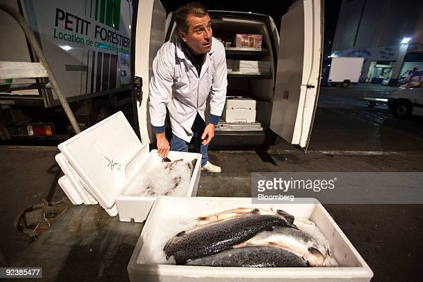 Gilles Morant loads his truck outside the seafood department at the Rungis wholesale food market the world's largest in Rungis near Paris France on...
