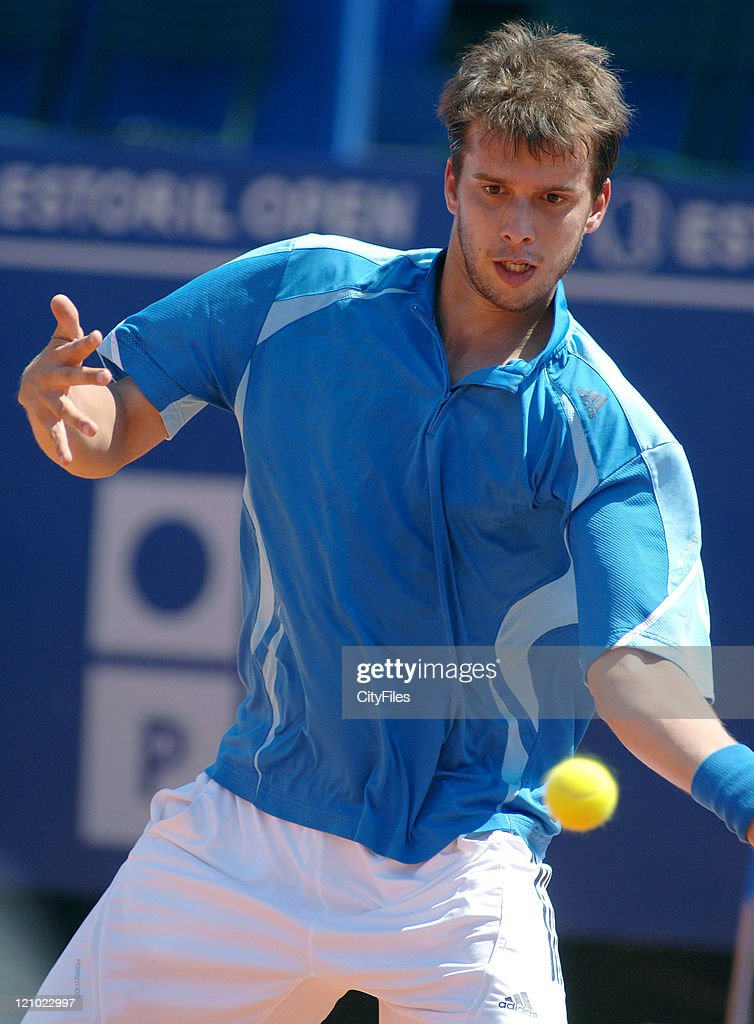 <a gi-track='captionPersonalityLinkClicked' href=/galleries/search?phrase=Gilles+Muller&family=editorial&specificpeople=224381 ng-click='$event.stopPropagation()'>Gilles Muller</a> hits a forehand during a match against <a gi-track='captionPersonalityLinkClicked' href=/galleries/search?phrase=Christophe+Rochus&family=editorial&specificpeople=235941 ng-click='$event.stopPropagation()'>Christophe Rochus</a> in the first round of the Estoril Open, Estoril, Portugal on May 1, 2006.