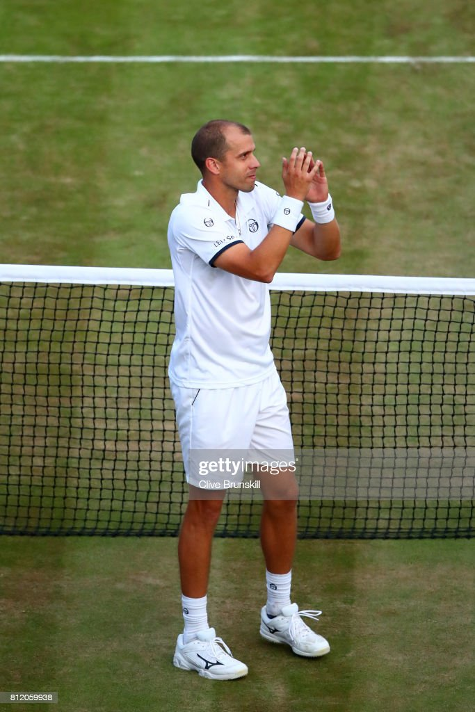 Gilles Muller of Luxembourg acknowledges the crowd as he celebrates victory after the Gentlemen's Singles fourth round match against Rafael Nadal of Spain on day seven of the Wimbledon Lawn Tennis Championships at the All England Lawn Tennis and Croquet Club on July 10, 2017 in London, England.