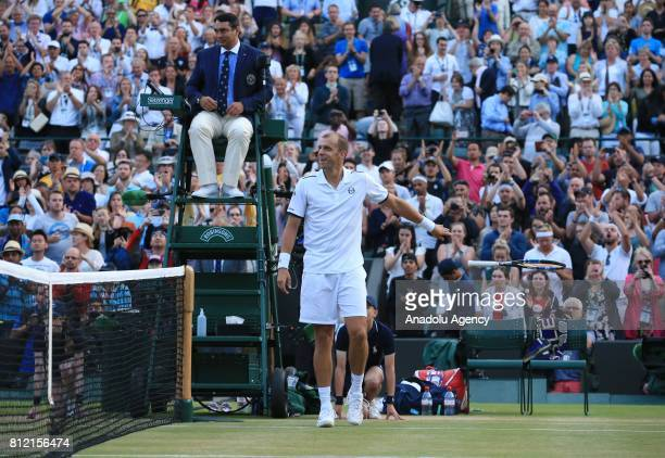 Gilles Muller of Luxembourg celebrates after beating Rafael Nadal of Spain on day seven of the 2017 Wimbledon Championships at the All England Lawn...